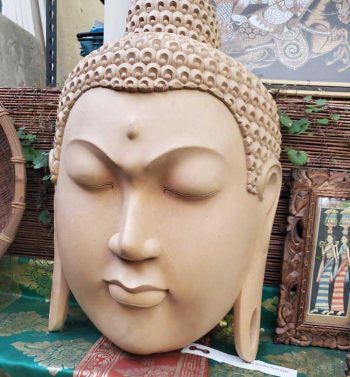 Carved wooden Buddha head $550
